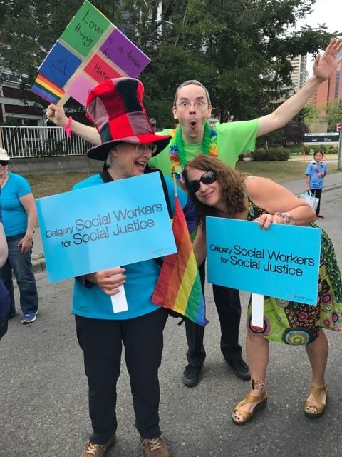 Yvonne Stanford, left, and social work prof Liza Lorenzett, right, at Pride parade with a friend.