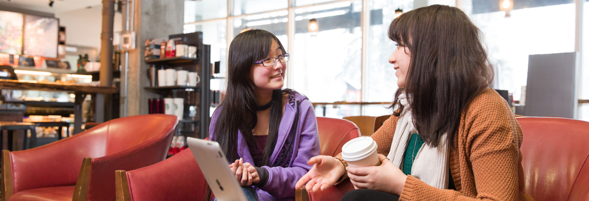 Two students discussing science mentorship program