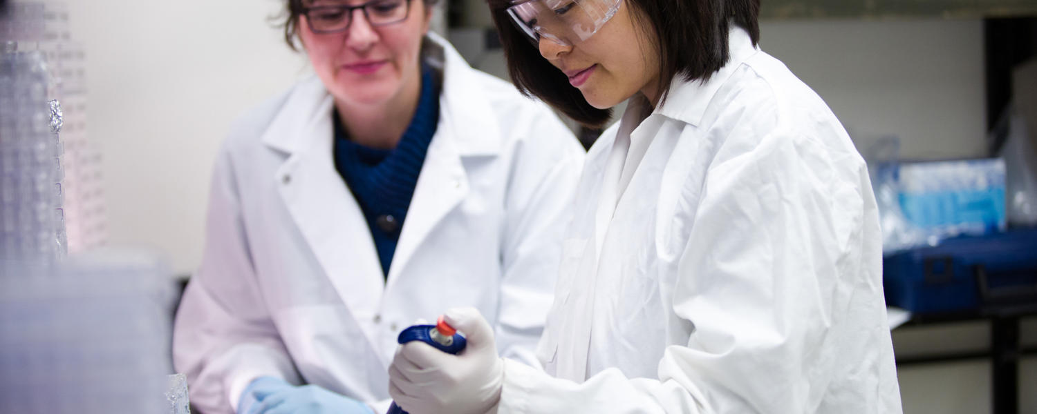 Female researcher takes samples in a lab