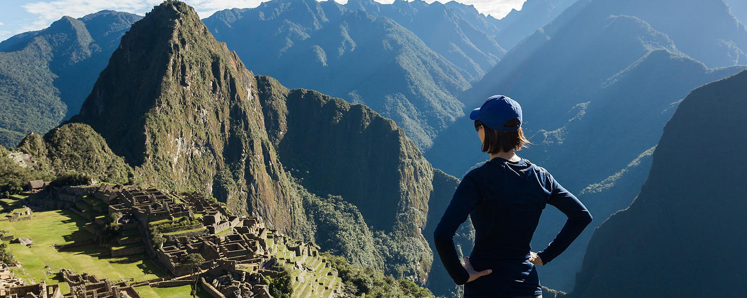Young woman overlooking Machu Picchu