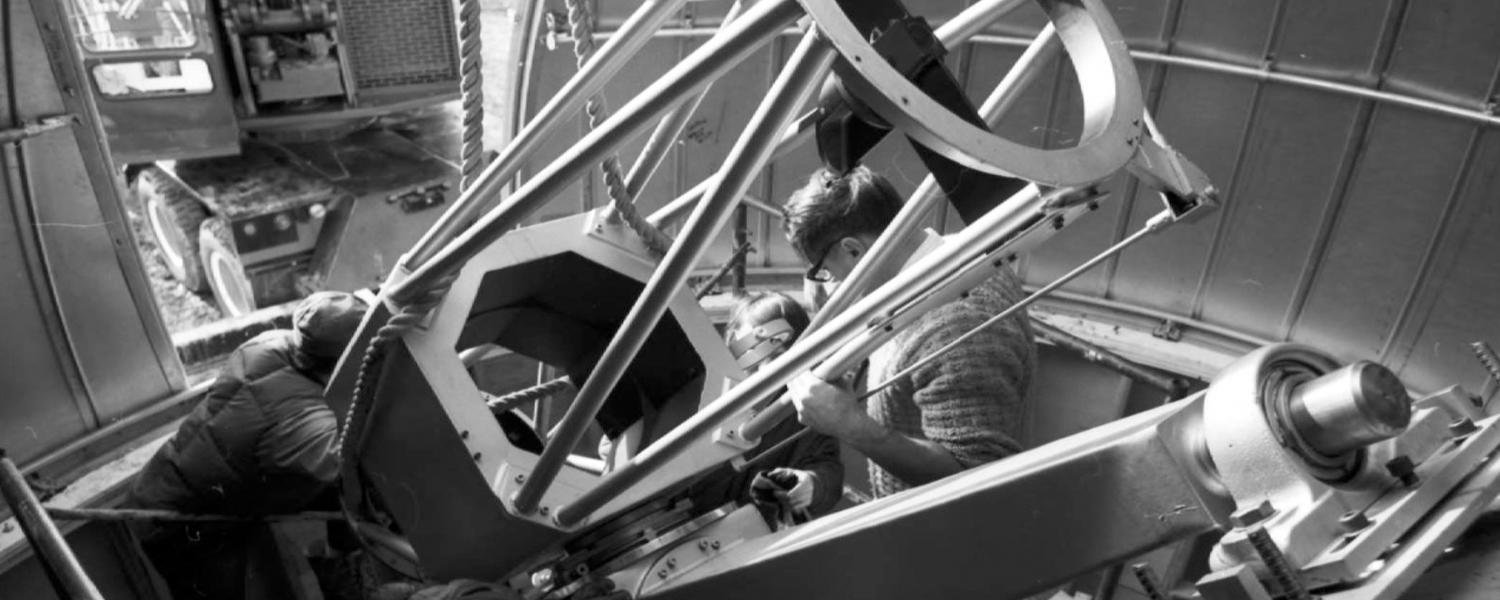 Image of installation of a telescope frame in one of the telescope domes at the Rothney Astrophysical Observatory at Priddis.