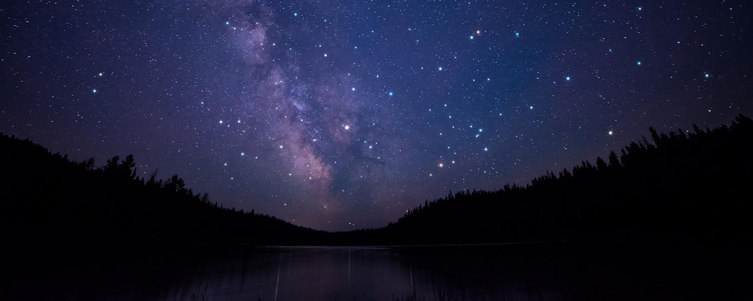 Starry sky over river.