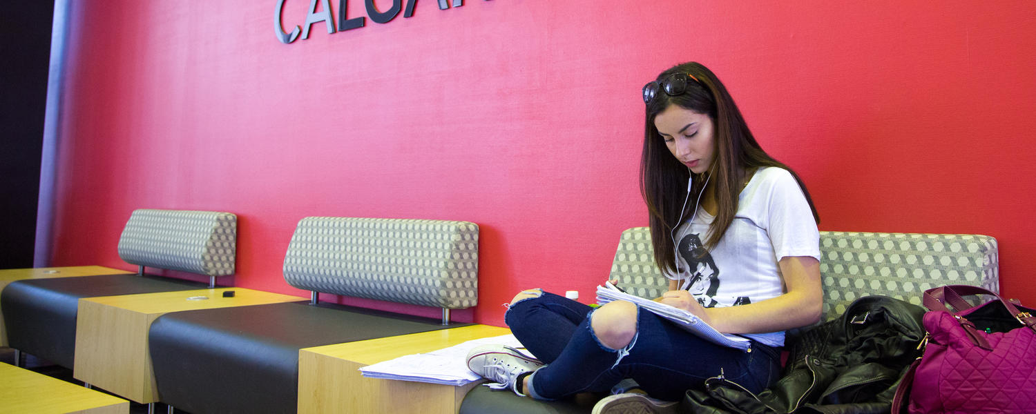 A female student studies intently.