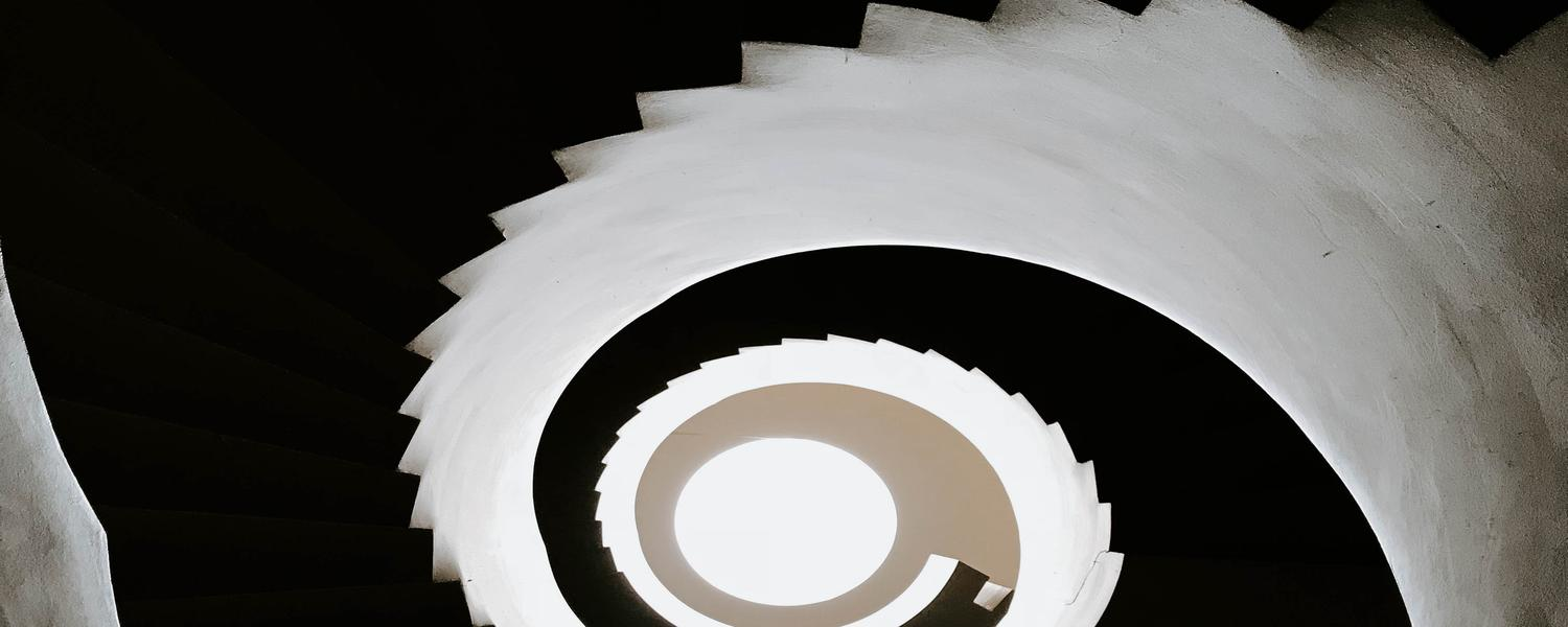 Shadowed spiral staircase.