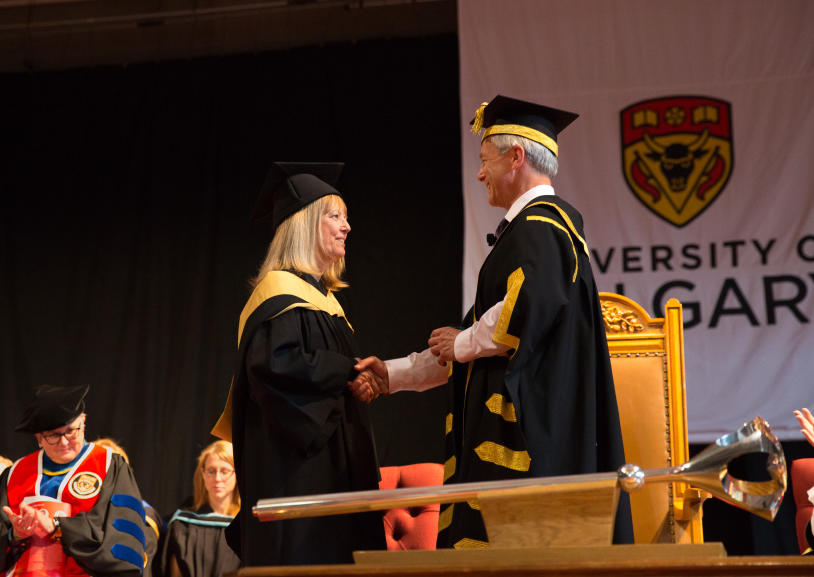 Viola Birss, professor in the Department of Chemistry, receives the Order of the University of Calgary from Chancellor Robert Thirsk at June 2018 convocation