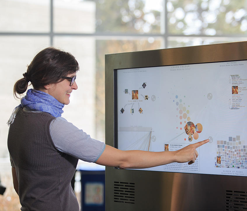 Grad student uses the Bohemian Bookshelf, a digital touch-screen library