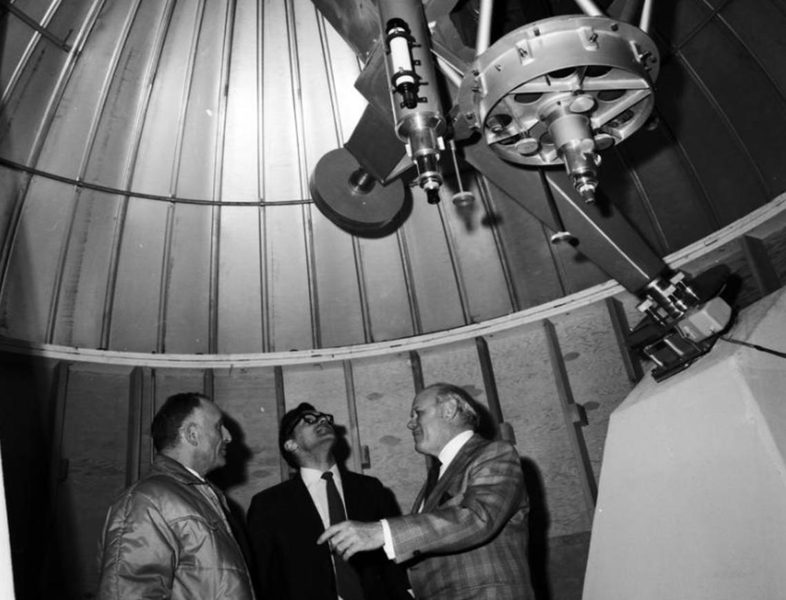 Image of dignitaries inside the telescope dome while attending the opening of the University of Calgary Astrophysical Observatory in Priddis in 1971.