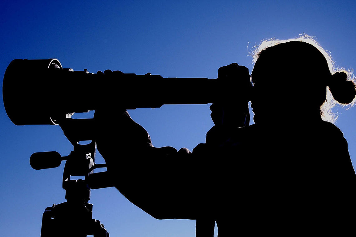 Person with telescope.
