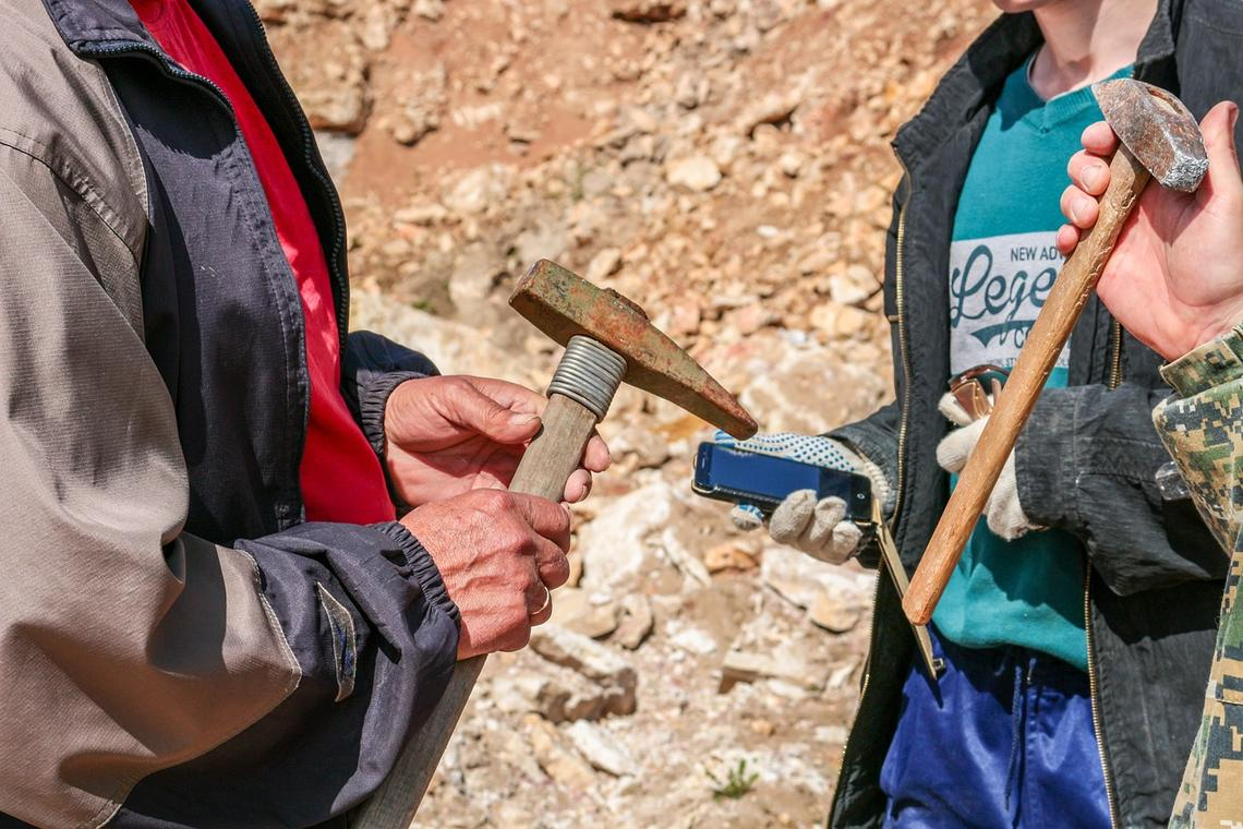 People holding geology tools