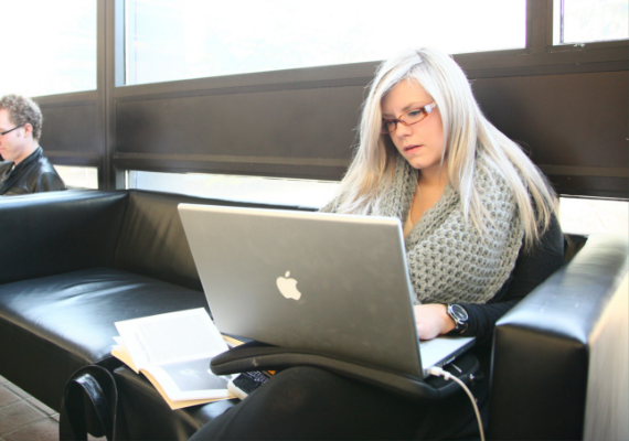 A female student uses a laptop computer.