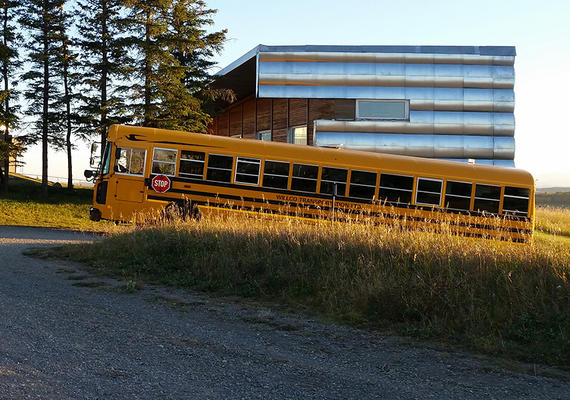 A school bus arrives at the Rothney Astrophysical Observatory.