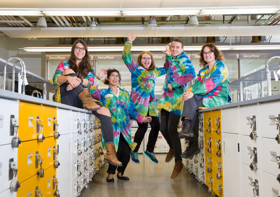 Chemistry students wearing rainbow tie-dye lab coats