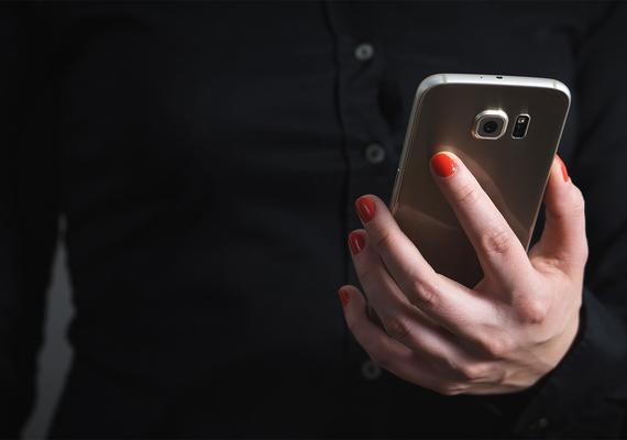 woman holding a smartphone