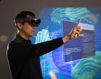 Markus Santoso, a postdoctoral fellow in the Faculty of Science, wears virtual reality glasses