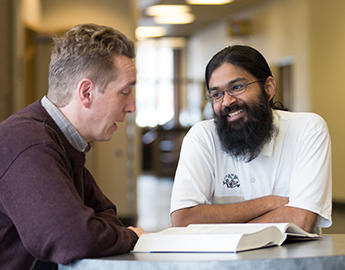 A professor and student work together as part of a mentorship program.