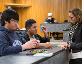 Students use lego during a lecture.